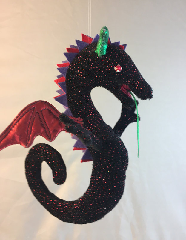 Wyvern in black with ruby sparkles